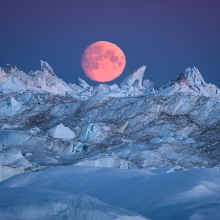 Moon rising over Icebergs in Ilulissat Icefjord, Greenland